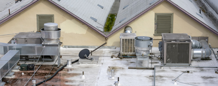 Replacement of a commercial roof with extensive, prolonged damage.