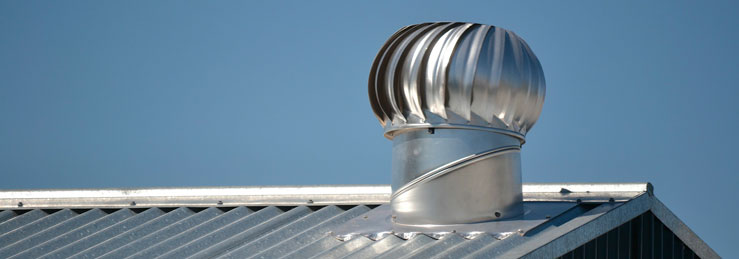 Metal roof vent on metal commercial roof.